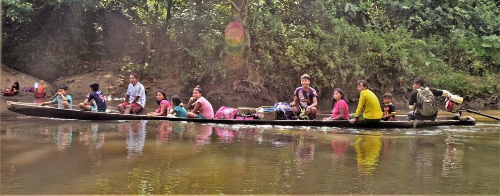 Achuar Family in a Peque Peque at Huituyaco River.