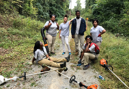 Interns after working on weed-eating part of the trail