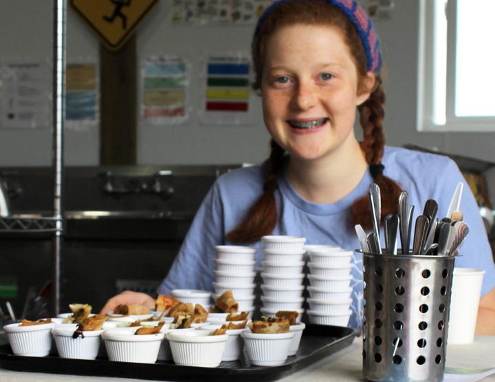 Farm Share Rx Recipe Samples – A youth farmer prepares recipe samples for Farm Share Rx program participants to taste.
